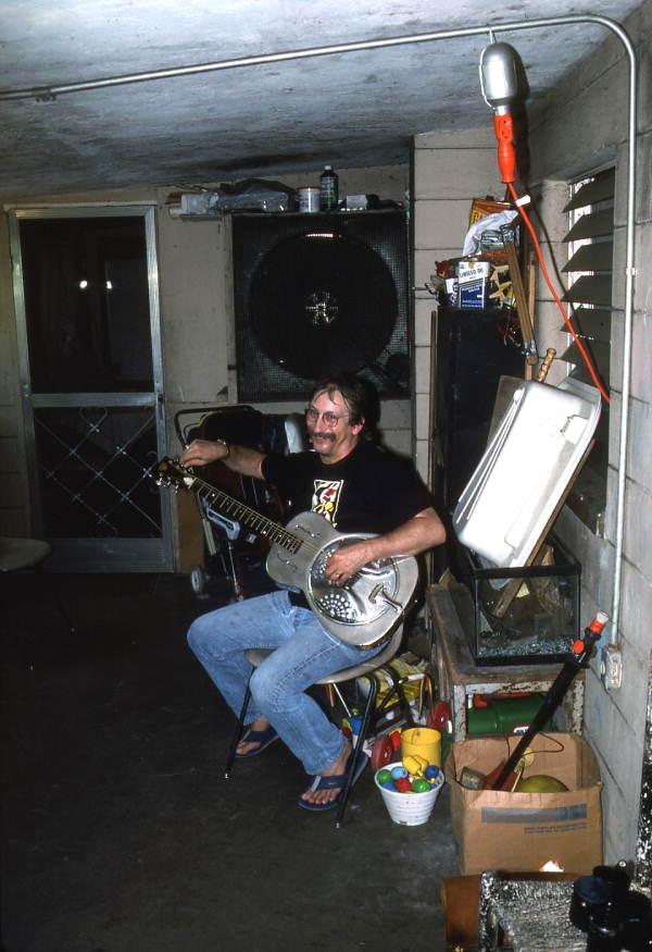 Tampa Blue playing slide blues guitar on a steel guitar- Tampa, Florida.