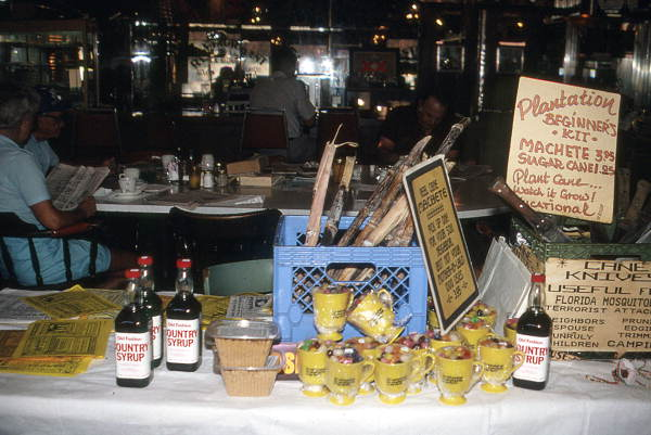 "Restaurant display of ""Plantation Beginner Kit"", with machetes, sugar cane, mugs and syrup - Clewiston, Florida."