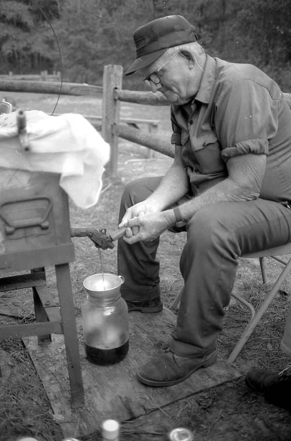 Harley Cason bottling sugarcane syrup - White Springs, Florida.