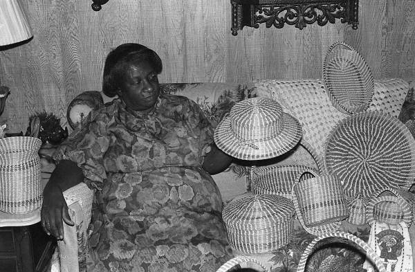 Mary Irene Foreman with her sweetgrass hat and baskets - Jacksonville, Florida.