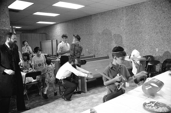 Florida Memory - Children and adults playing during Purim