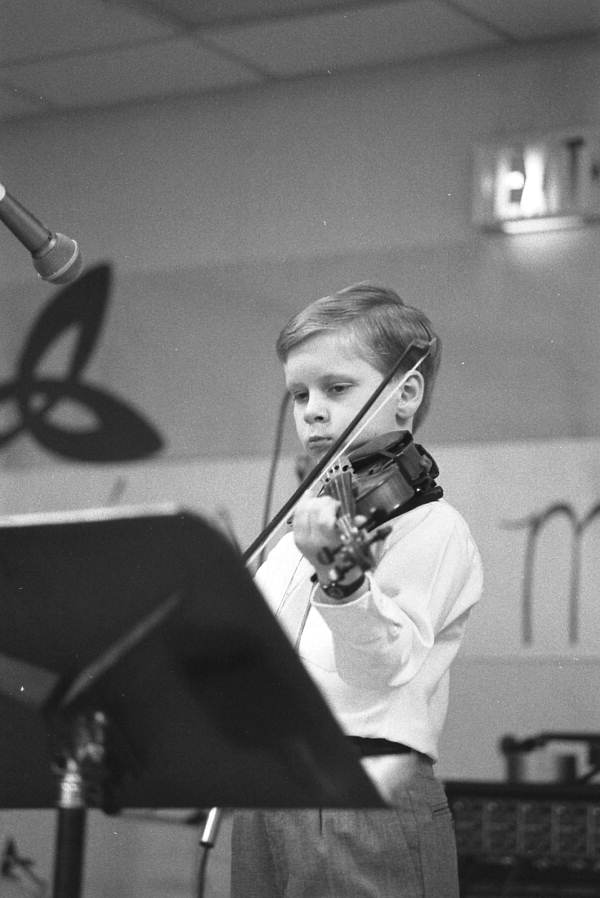 Young boy playing the fiddle - Jacksonville, Florida.