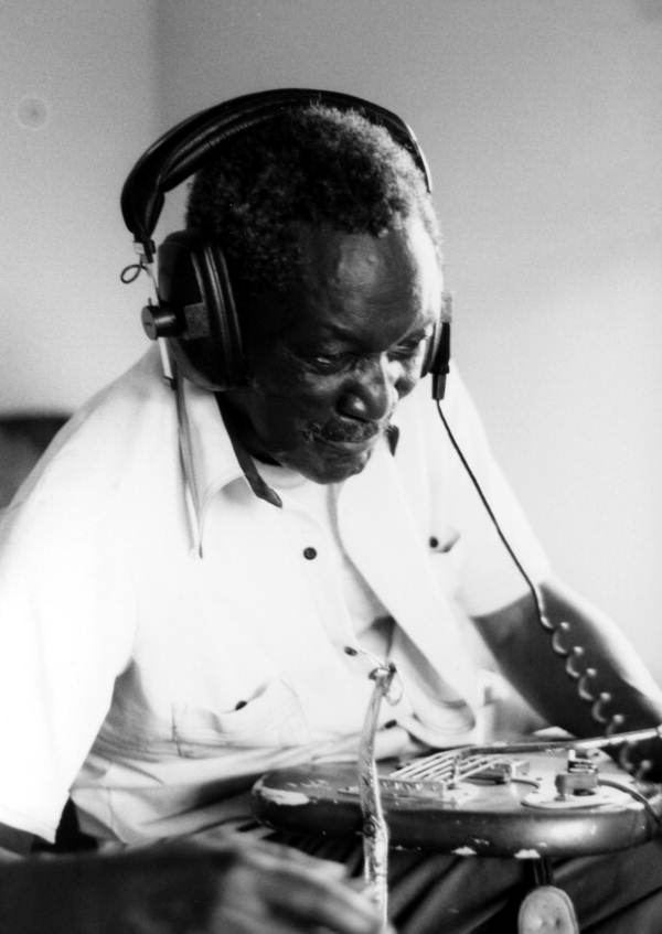 Emmett Murray with headphones on at a recording session- Belle Glade, Florida.
