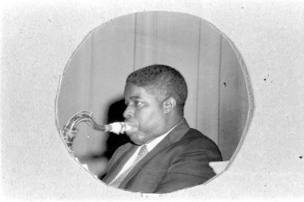 Portrait of Albert Ashley playing the saxophone - Pensacola, Florida.