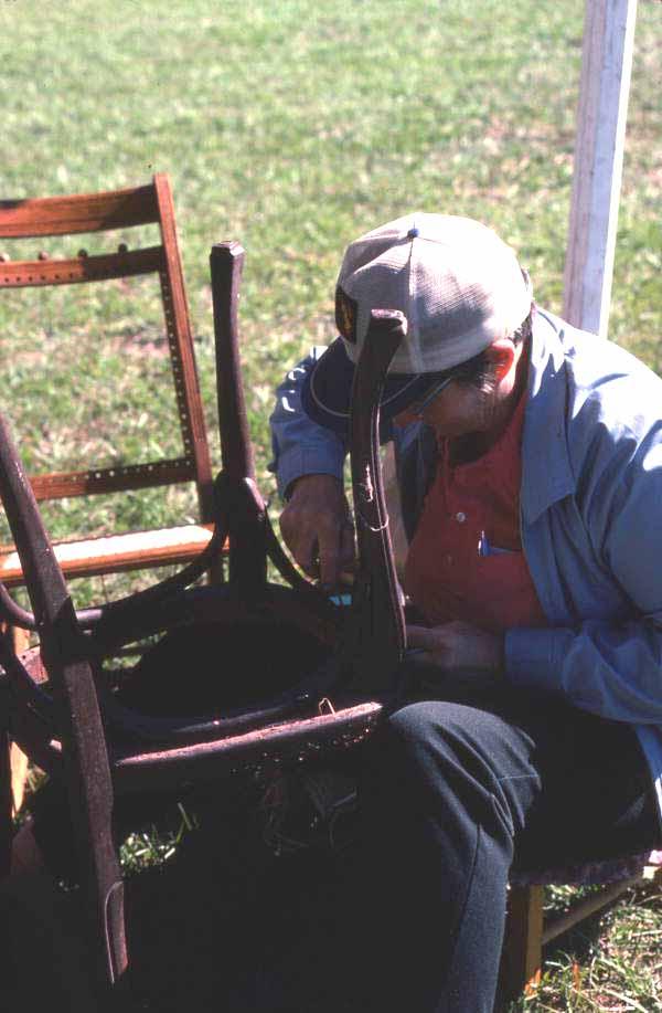 Craftsman making a chair at Pioneer Days - Orlando, Florida.