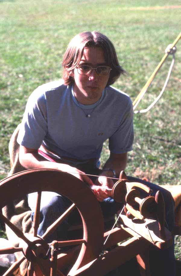 Teen using a sewing machine at Pioneer Days - Orlando, Florida.