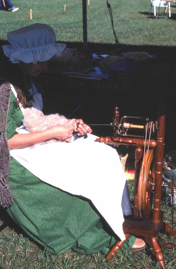 Costumed interpreter sewing at Pioneer Days - Orlando, Florida.