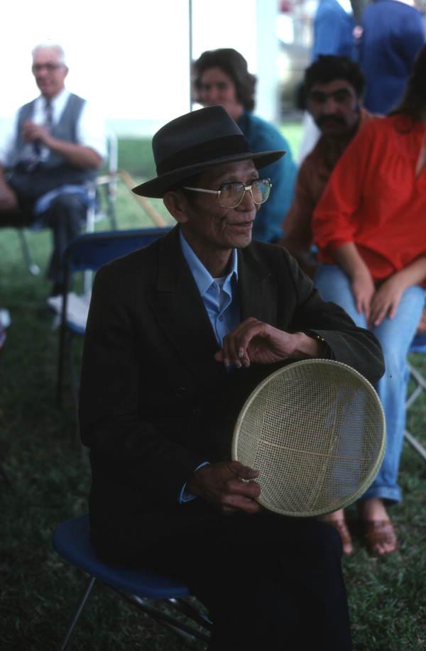 Tuyen Pham holding a basket - Pensacola, Florida.