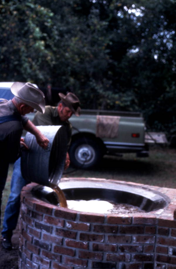 Pouring out sugar cane syrup - Orlando, Florida.