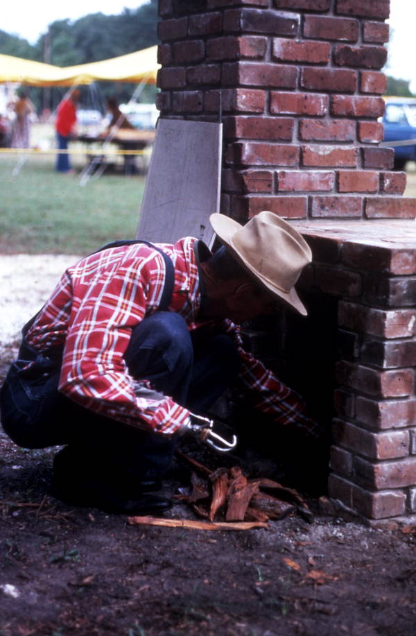 Placing firewood in the fireplace - Orlando, Florida.