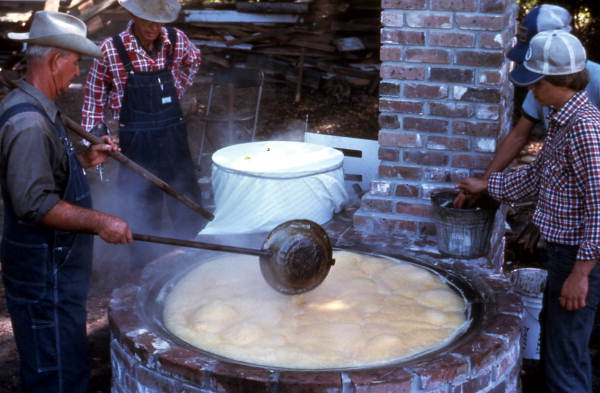 Cooking sugar cane juice into syrup - Orlando, Florida.