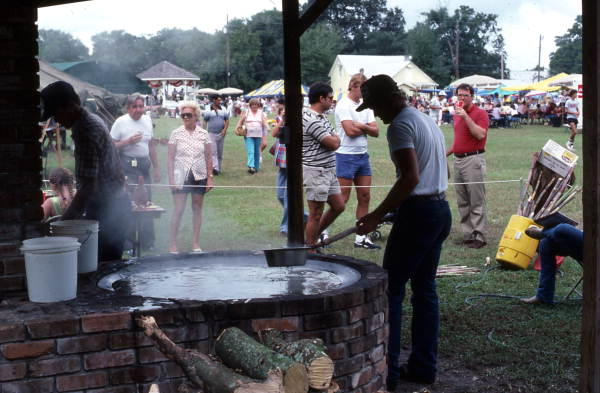 Stirring syrup at Pioneer Days - Orlando, Florida.