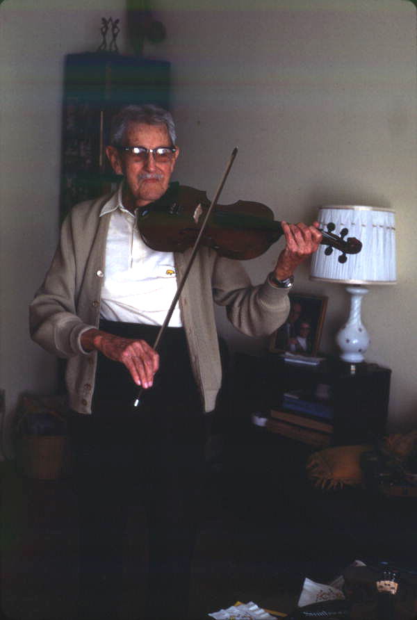 Otinus Busness playing one of the violins he made - Jacksonville, Florida.