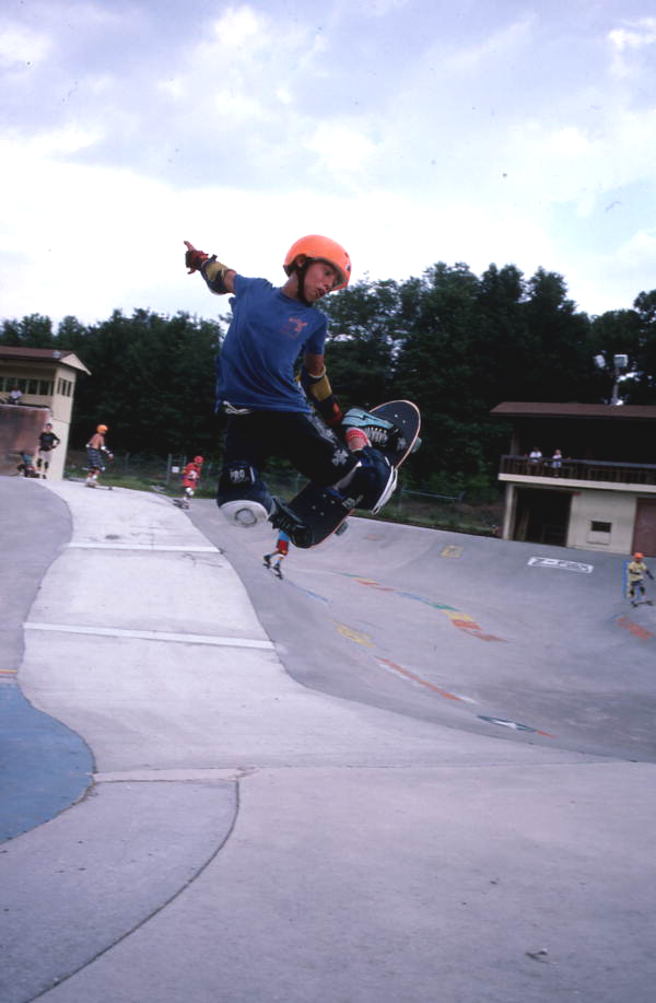 Skateboarder performing an aerial move - Jacksonville, Florida.