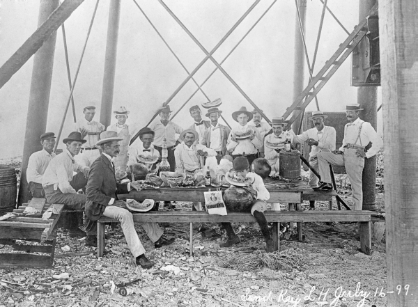 Men having a picnic at the Sand Key Lighthouse located 7 miles southwest of Key West.
