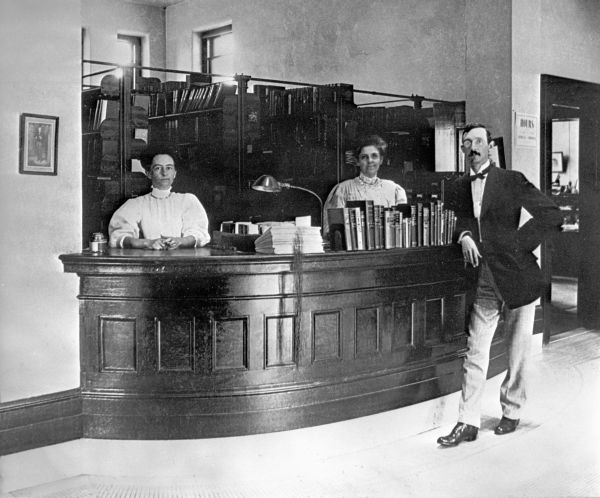 Library staff at circulation desk.