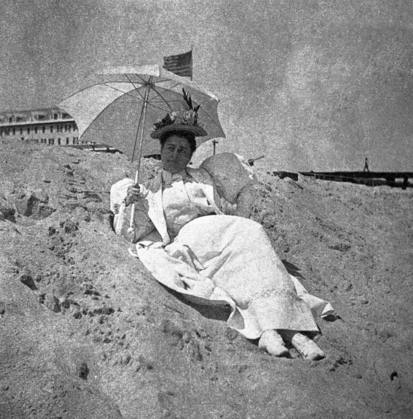 Lady in white reclining on the beach - Palm Beach, Florida.