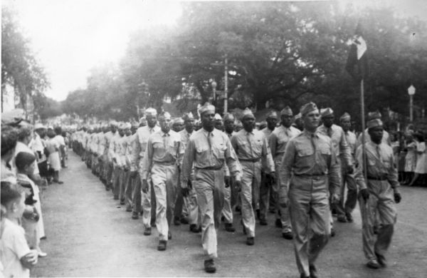 African American troops marching in Governor Millard Caldwell's inaugural parade in Tallahassee, Florida.