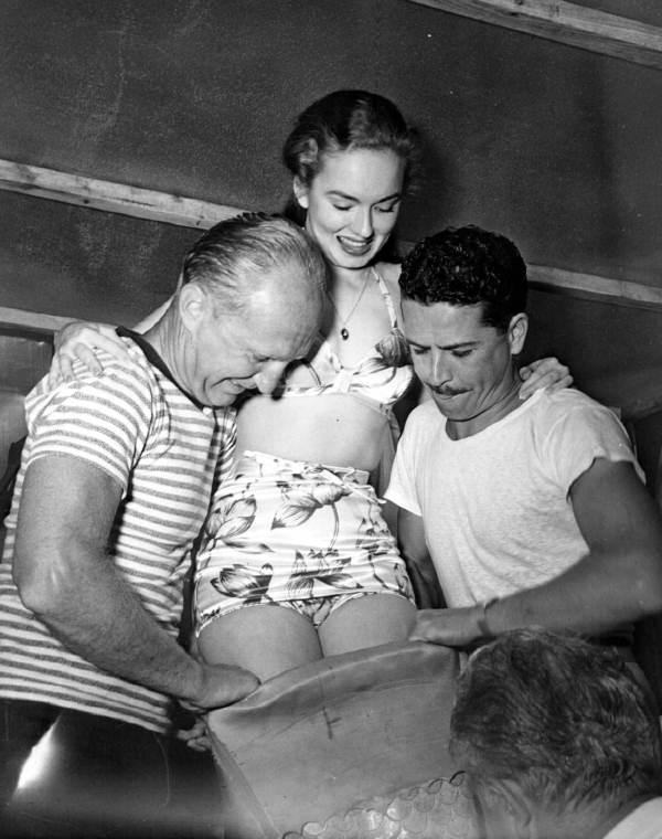 Staff helping Ann Blyth fit into her tail - Weeki Wachee Spring, Florida.