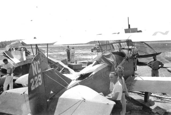 Checking damage to planes after a tornado - Tallahassee, Florida.