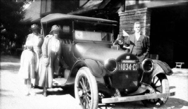 Family posing around car - Jacksonville, Florida.