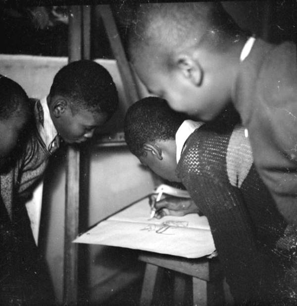 Children drawing at the Jacksonville Negro Art Center of the WPA Federal Art Project- Jacksonville, Florida.