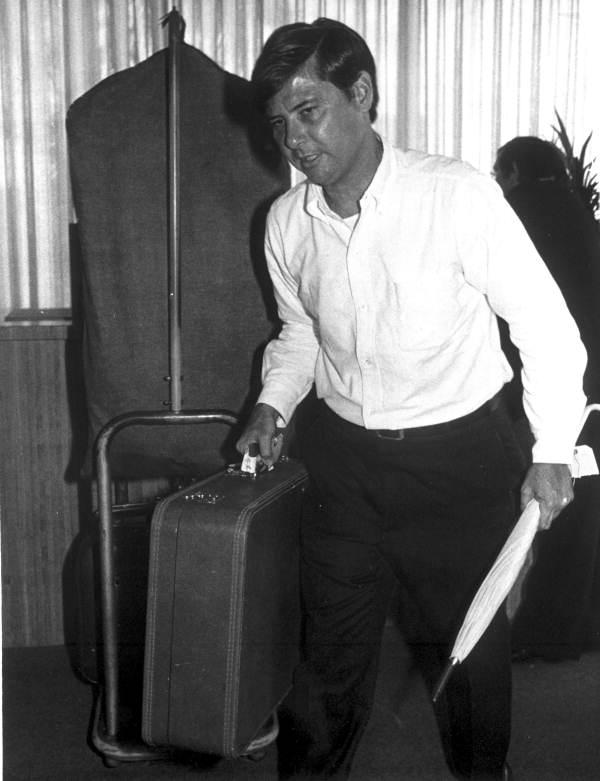 Florida State Senator Bob Graham during work day as a bellhop - Orlando, Florida.