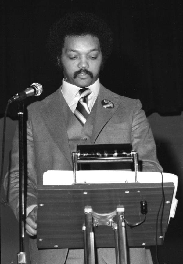 Civil rights leader Jesse Jackson delivering a speech in an auditorium - Tallahassee, Florida.