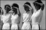 Young campers saluting at the FERA camp for unemployed women - Anastasia Island, Florida