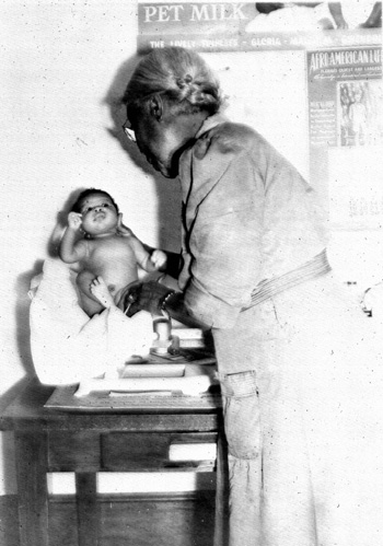 Nurse McGreen weighing an infant: Leon County, Florida (1944)