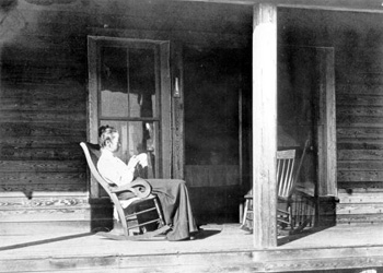 Henriette Martens sitting in a rocking chair on the porch of her home: Miami, Florida