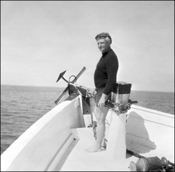Treasure hunter Art McKee standing at the bow of a boat (1967)