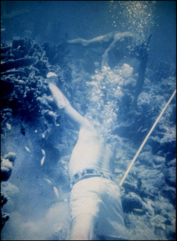 Art working edge of ballast pile of what is believed to be the Genovesa shipwreck (1979)
