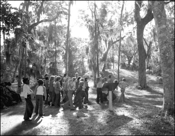 Visitors viewing the Indian mounds at Crystal River Archaeological State Park (1975)