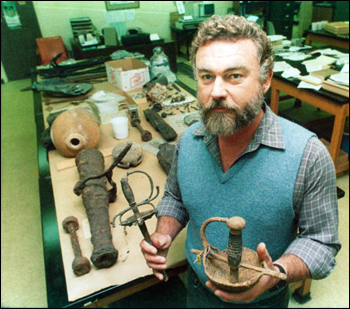 Roger Smith, the State Archaeologist stands with some artifacts : Tallahassee, Florida (1987)