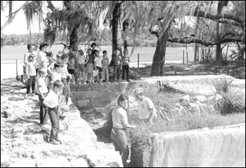 Archaeologists showing children excavated ruins of Fort San Marcos de Apalache (1965)