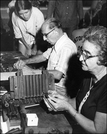 Faustino and Consuelo Fernandez of Tampa demonstrating cigar rolling at the 1977 Florida Folk Festival: White Springs, Florida (1977)