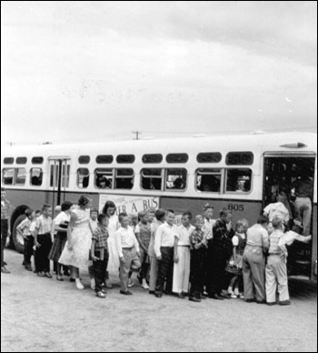 Children boarding bus for school: Saint Petersburg, Florida (October 1956)