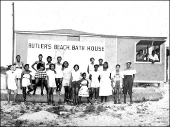 Beach-goers assembled for a group portrait by the bath house at Butler Beach: Anastasia Island, Florida (195-)