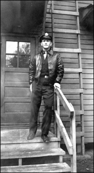 Pilot Ralph Esterling on the steps of the barracks (1944)