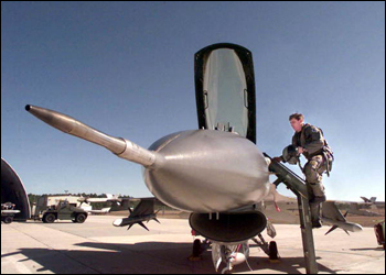 Pilot climbing into an F16 jet fighter airplane at Eglin Air Force Base (2000)