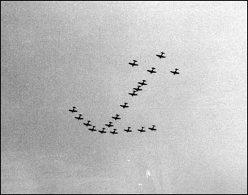 Naval air reserve training unit flyover in the shape of an anchor: Jacksonville, Florida (1948)