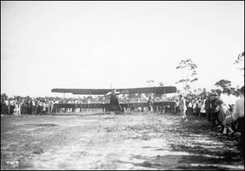 Crowd gathered around a biplane, part of Mabel Cody's Flying Circus: Coral Gables, Florida (1922)