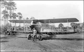 Man posing in front of a biplane, part of Mabel Cody's Flying Circus: Coral Gables, Florida (1922)