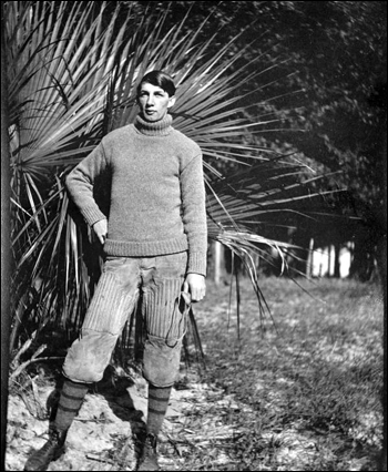 Stetson University player, holding faceguard, early 1900s, Deland, Florida