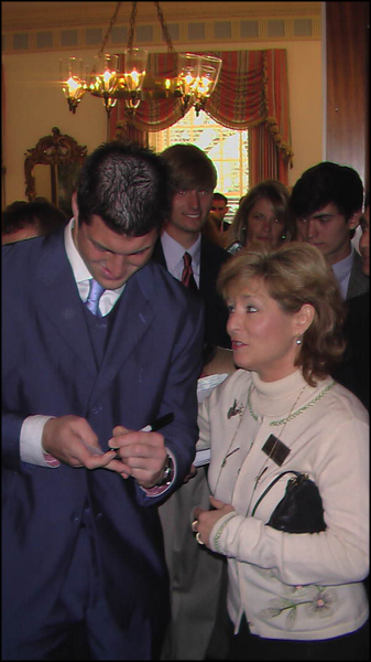 State Representative Michelle Rehwinkel Vasilinda, D-Tallahassee, getting an autograph from University of Florida quarterback Tim Tebow during a visit to the Governor's Mansion: Tallahassee, Florida (2009)
