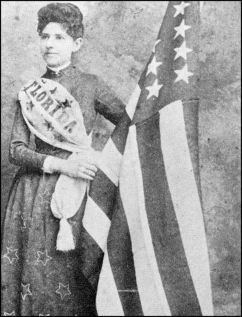 Mena E. Williams Hirshberg stands by a U.S. flag: Tallahassee, Florida (1885)
