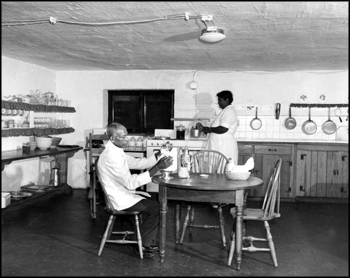 Grove staff members at work in the kitchen (1956)