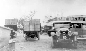 Trucks loaded with coffins, after the hurricane of 1928: Belle Glade (?), Florida
