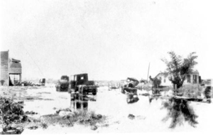 "View of Avenue ""A"", flooded after the hurricane of 1928: Belle Glade, Florida"